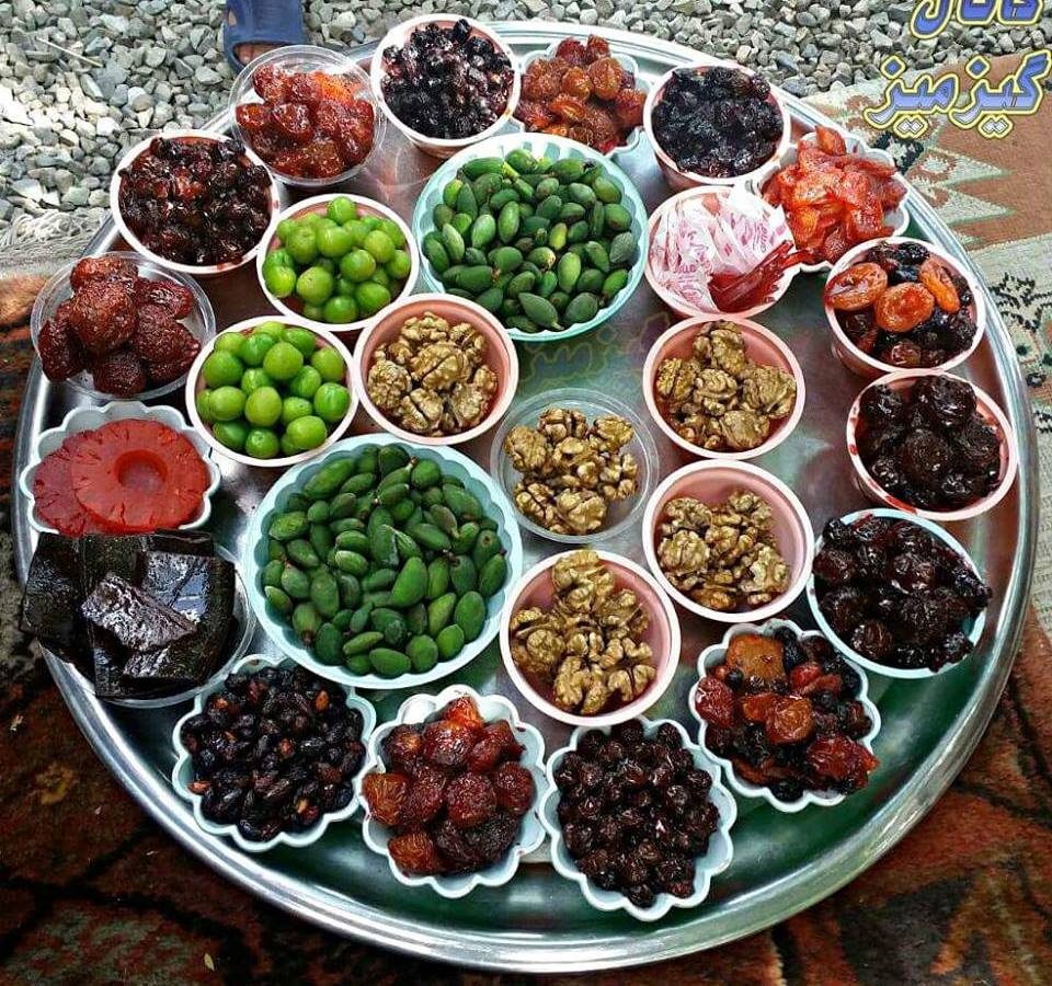 Photo of a tray holding a variety of persian snack foods for Aria persian cuisine