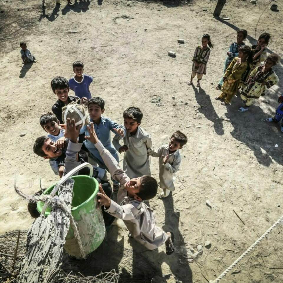 ... Impoverished kids in southeastern Iran playing a version of basketball