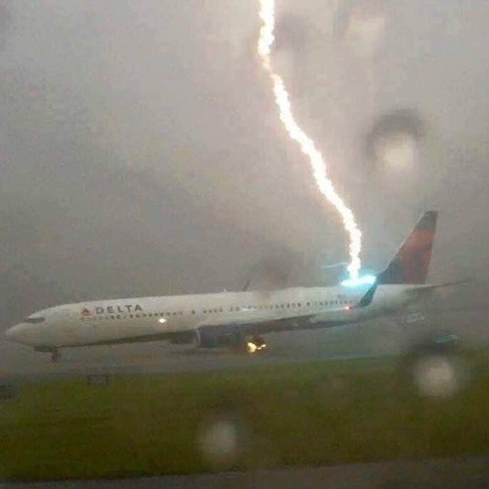f2d76b7ca0e8 Perfectly-timed photo  Lightning bolt strikes a Delta passenger jet ...