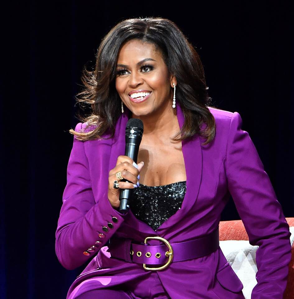 0dbad67a5c7 ... Michelle Obama in a stunning purple outfit