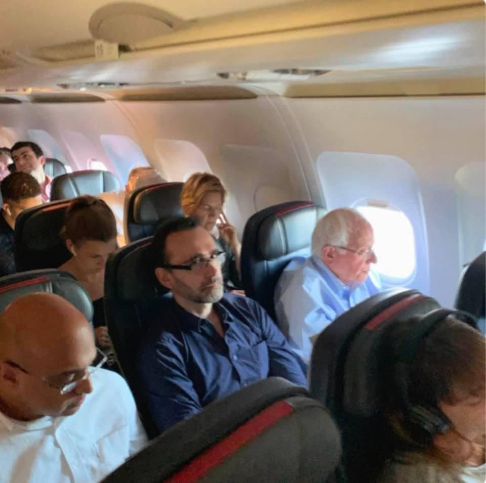 999c2a3a6 Photo of Bernie Sanders and Elizabeth Warren on a flight to Miami ...