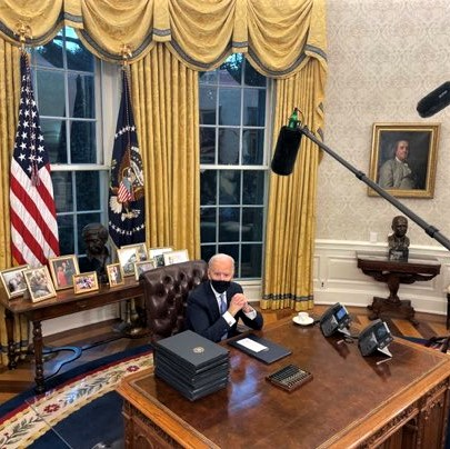 Biden, shown behind his Oval Office desk, after inauguration ceremonies