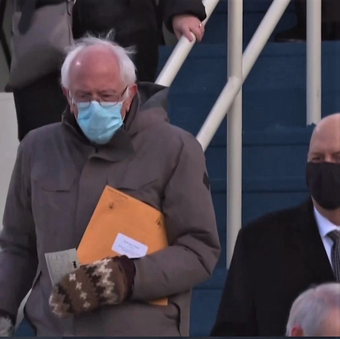 Bernie Sanders at inauguration carrying a mysterious envolope