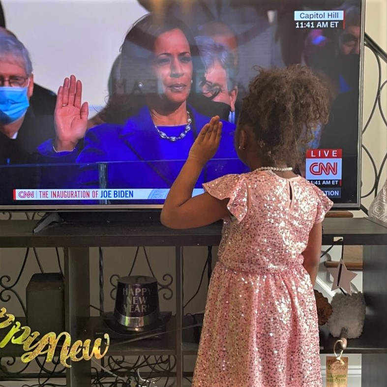 Photo posted by Nyshawana Francis-Thompson, Ed.D., of her daughter joining Madam VP Harris during her swearing-in ceremony