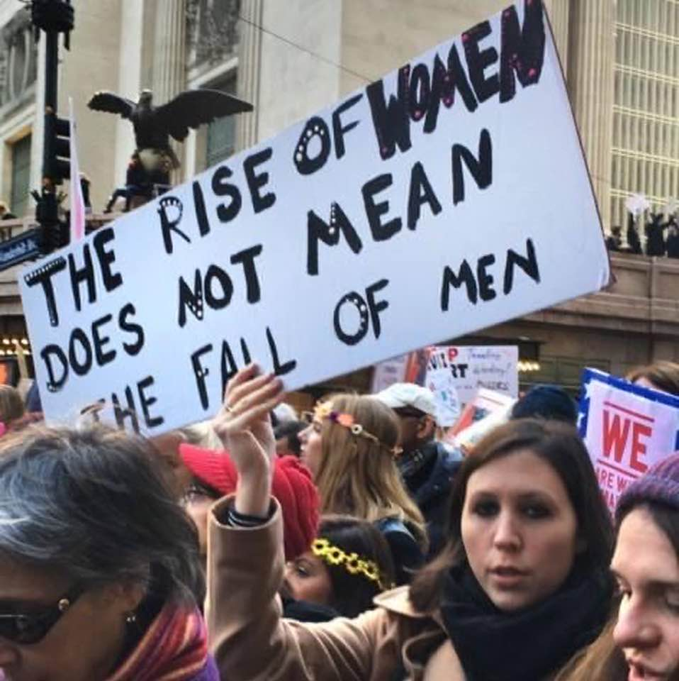 Protest sign: 'The rise of women does not mean the fall of men