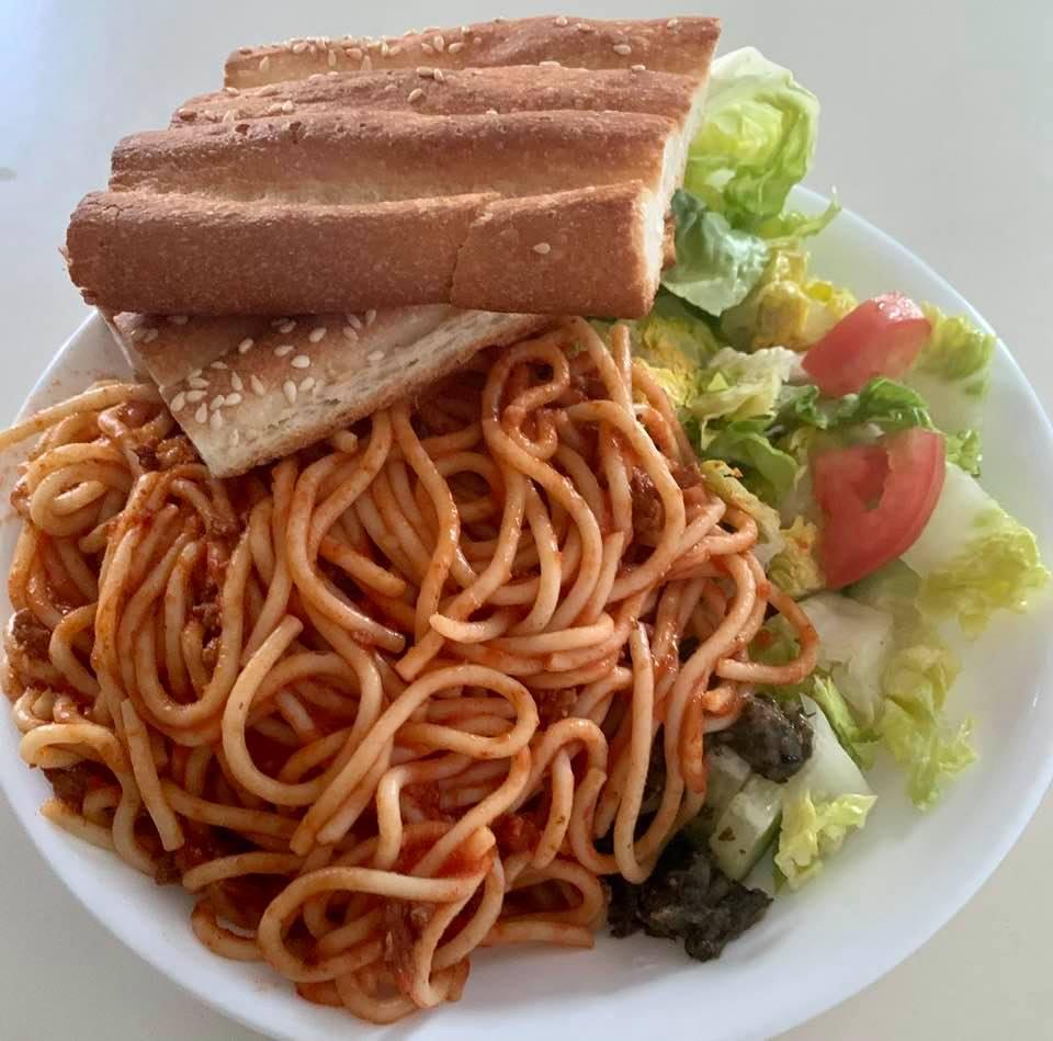 International combo meal: Pasta, salad, and barbari bread