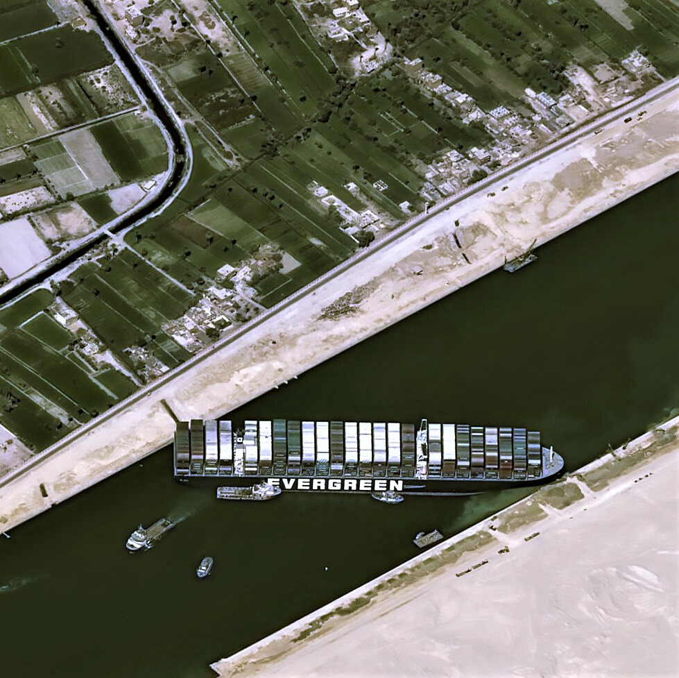 Photo showing the Suez Canal blocked by a container-ship stuck across it
