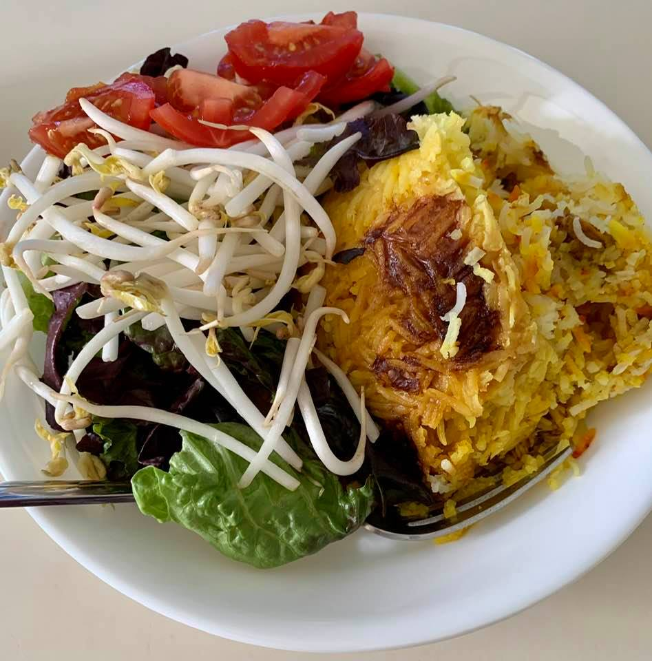 Tah-chin (rice layered with chicken, flavored with yogurt and saffron), courtesy of my mom, plus salad