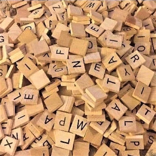 I am excited about the book I bought from Ikea! (A large pile of Scrabble tiles)