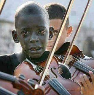 Diego Frazzo Turkato, 12, weeps at his music teacher's funeral, playing a favorite song that saved him from poverty and despair