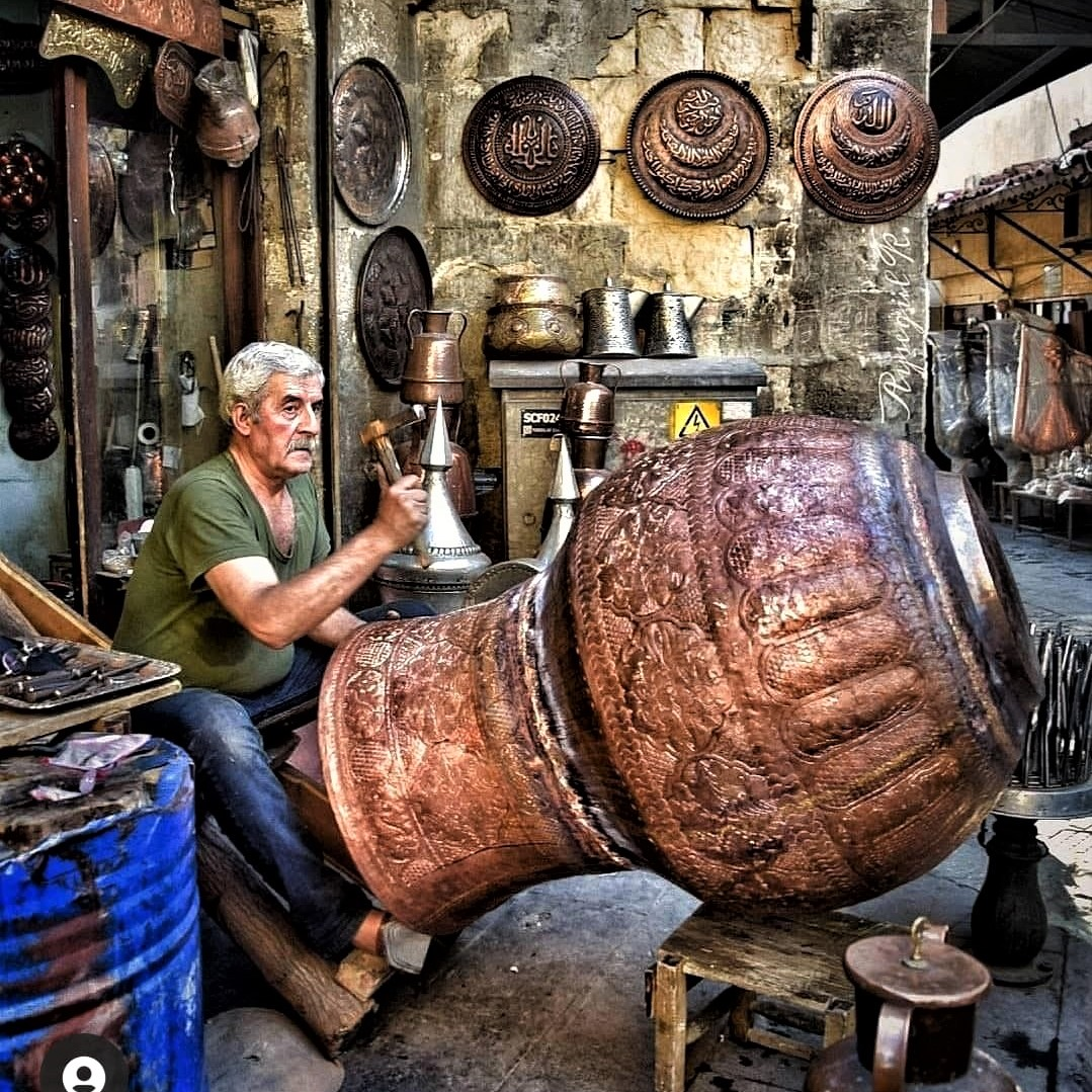 Artist at work in Esfahan's copper market, built in Iran's Safavid era, some 400 years ago
