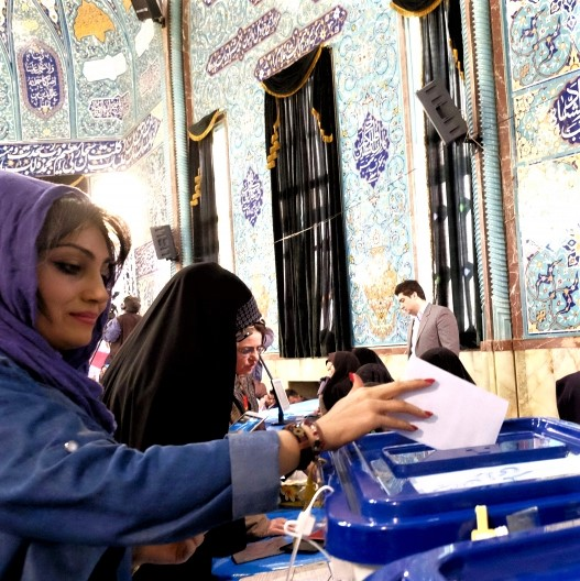 Iranian women shown at ballot boxes